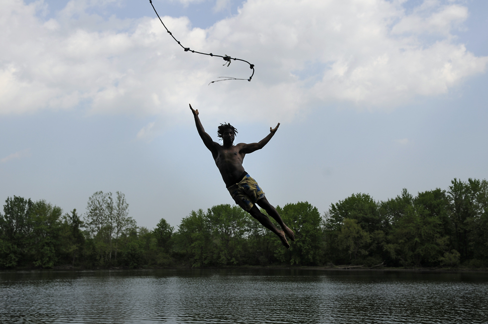 2013.05.21 - Farmington, CT - Tyrell Eason of Bristol takes the plunge off a rope swing in Farmington on the Farmingto River Tuesday afternoon as temperatures reached into the 90's for the first time this year.
