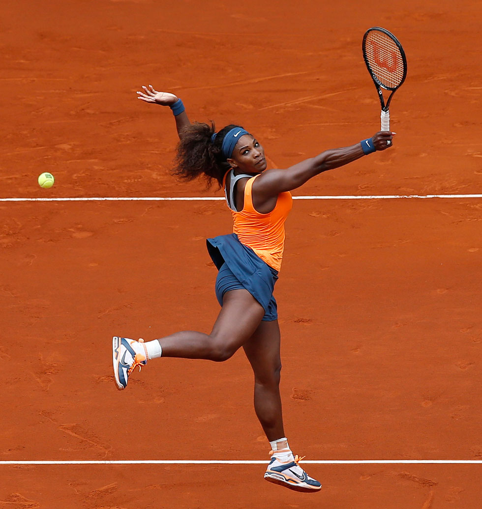 Serena Williams celebrates after winning her tennis match against Spanish player Lourdes Dominguez Lino at the Madrid Masters, May 7, 2013. REUTERS/Juan Medina