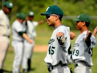 2013.05.17 - Manchester, CT -Stalys Delos Santos leads his teammates in series of stretches before taking the field. Despite the losing streak day in and day out the team members, some playing baseball for the first time, show up for practices and games.
