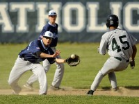 2013.05.17 - Manchester, CT - Jaysen Nunez of East Catholic waits for the ball as Stalys Delso Santos tries to steal second base but was easily picked off when he hesitated en route.