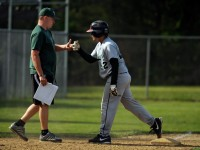 2013.05.17 - Manchester, CT -  Head coach Jamie Verab gives a fist pump to Luis Majias after reaching third base late in the game. Majias later scored for one of the Beaver's 2 runs in a 12-2 loss as their losing streak stretched to 70 straight games.