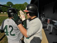2013.05.17 - Manchester, CT - Erick Diaz (R) high-fives Luis Majias after he scored one of Weaver's 2 runs in a 12-2 loss to East Catholic Friday afternoon.