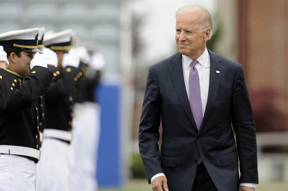 2013.05.22 - New London, CT - Vice President Joe Biden walks by a cordon of cadets on the way to the stage at the U.S. Coast Guard Academy's 132nd commencement in New London Wednesday.