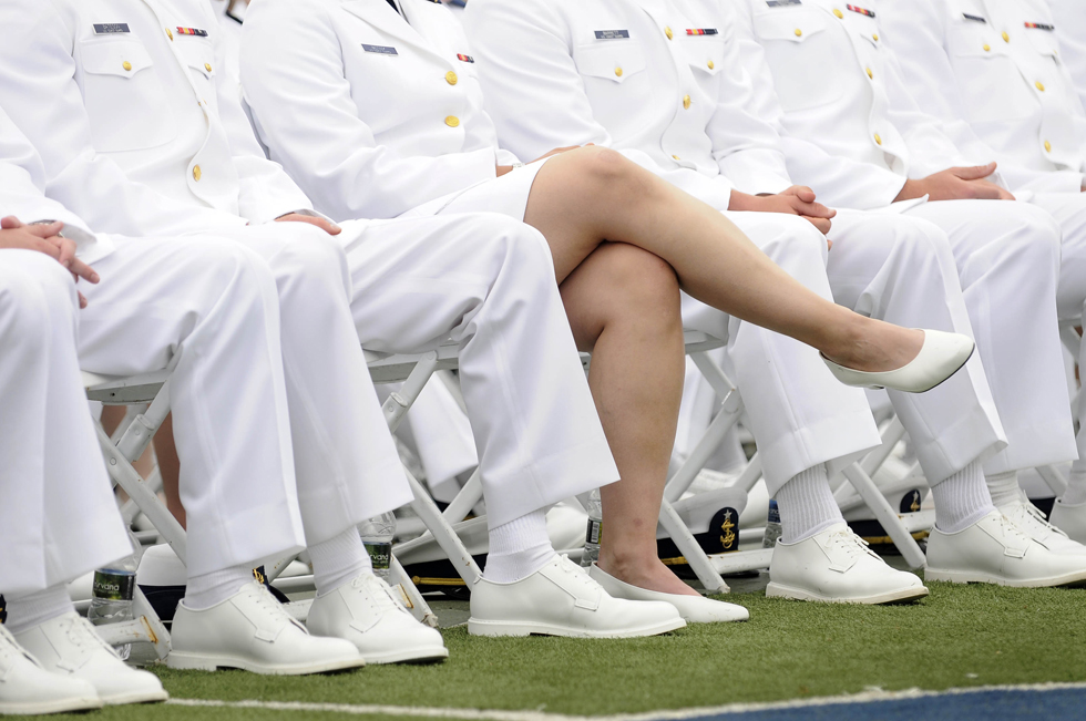2013.05.22 - New London, CT - A female cadet sits among male classmates at the U.S. Coast Guard Academy's 132nd commencement in New London.