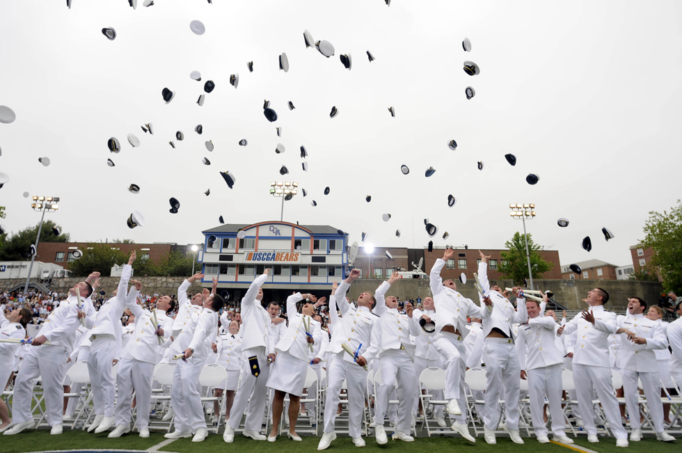 2013.05.22 - New London, CT - Newly commissioned officers toss their cadet hats into the air at the end of the U.S. Coast Guard Academy's 132nd commencement.