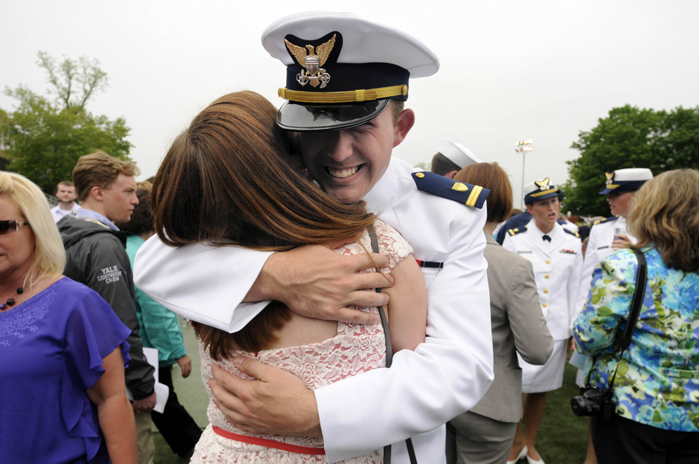 2013.05.22 - New London, CT - Tyler Bittner, of Seoul, South Korea, hugs his girlfriend Olivia Roome, of Southbury, after the U.S. Coast Guard Academy's 132nd commencement.