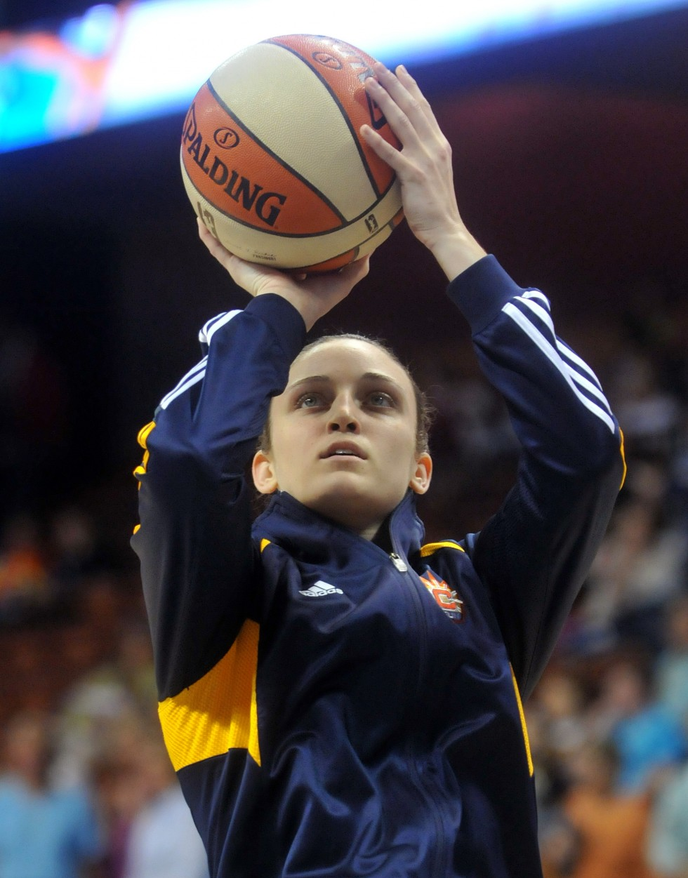 Former UConn standout and Connecticut Sun rookie Kelly Faris warms up before her first professional game against the New York Liberty at Mohegan Sun Arena Saturday night.  Connecticut Sun forward Mistie Bass, Kelly Faris and New York Liberty's Cappie Pondexter in action at the Sun season opener at Mohegan Sun Arena Saturday night. Photo by BRAD HORRIGAN   bhorrigan@courant.com