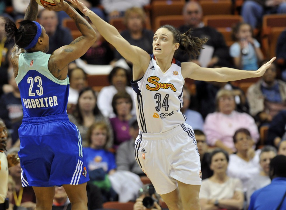 Connecticut Sun's Kelly Faris contests the shot of New York Liberty's Cappie Pondexter at the Sun season opener at Mohegan Sun Arena Saturday night. Photo by BRAD HORRIGAN | bhorrigan@courant.com