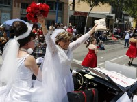 Civil rights lawyer Gloria Allred wears a wedding dress while riding in support of Marriage Equality during the 43rd annual L.A. LGBT Pride Parade in West Hollywood June 9, 2013. The parade celebrates the lesbian, gay, bisexual and transgender communities in Los Angeles. REUTERS/Patrick T. Fallon