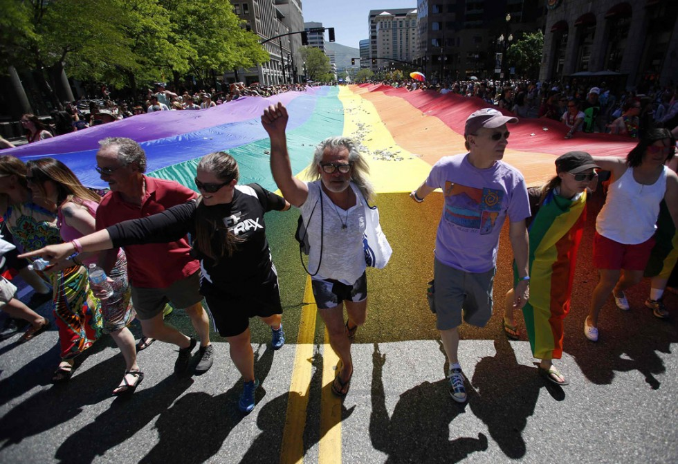 Gay rights supporters march with a rainbow flag during the gay pride parade in Salt Lake City, Utah, June 2, 2013. REUTERS/Jim Urquhart