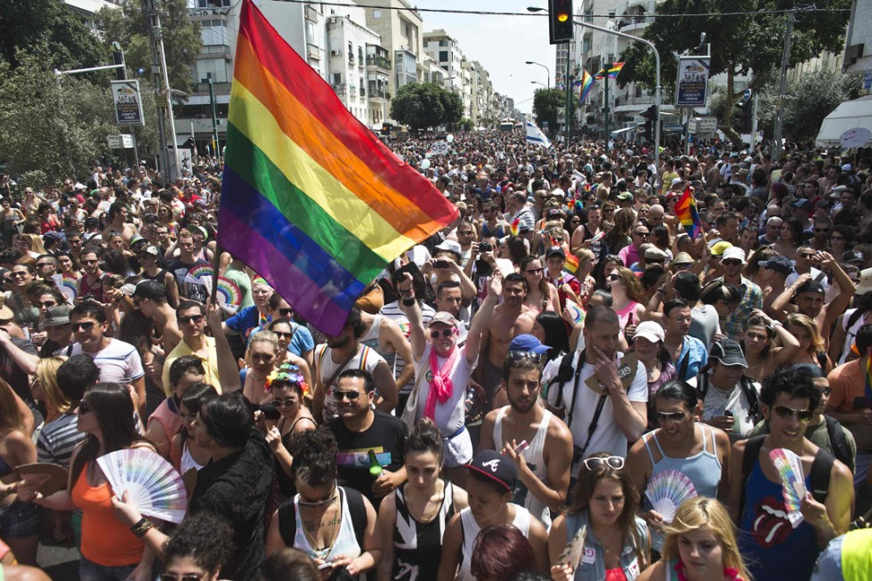 People take part at the annual Gay Pride parade in Tel Aviv June 7, 2013. Thousands of revelers on Friday paraded on the streets of Israel's free-wheeling city of Tel Aviv, which has become a Mediterranean hotspot for gay tourism. REUTERS/Nir Elias