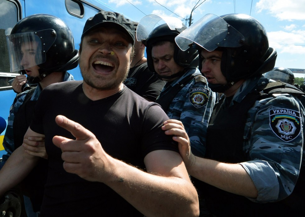 Police displace an Orthodox believer protesting against a Gay Parade in Kiev on May 25, 2013. Around a hundred gay rights activists marched in Ukraine on Saturday despite fears of violence and a court ban, marking the first gay pride event in the ex-Soviet country, where homophobia is widespread and generally accepted. AFP PHOTO/ SERGEI SUPINSKY/AFP/Getty