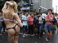 People take a photograph of a reveller during the 17th Gay Pride parade in Sao Paulo June 2, 2013. REUTERS/Paulo Whitaker