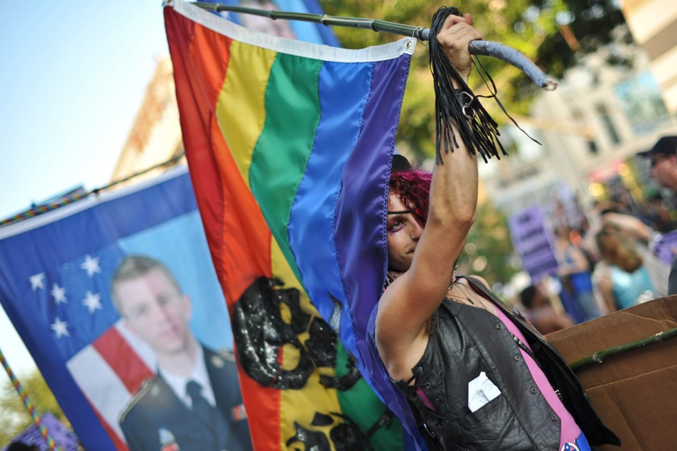 People call for thre release of Wikileaks whistleblower Bradley Manning during the 2013 Capital Pride parade in Washington on June 8, 2013. This year is the 38th such annual gay pride parade to take place in the US capital.   AFP PHOTO/NICHOLAS KAMM/AFP/Getty Images
