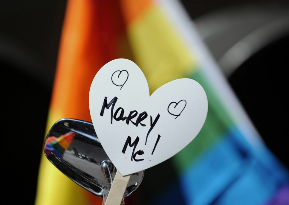 A sign on a motorcycle during the New York City gay pride march June 26, 2011. The New York state legislature voted June 24 to become the sixth state in the US to legalize same-sex marriage. STAN HONDA/AFP/Getty Images