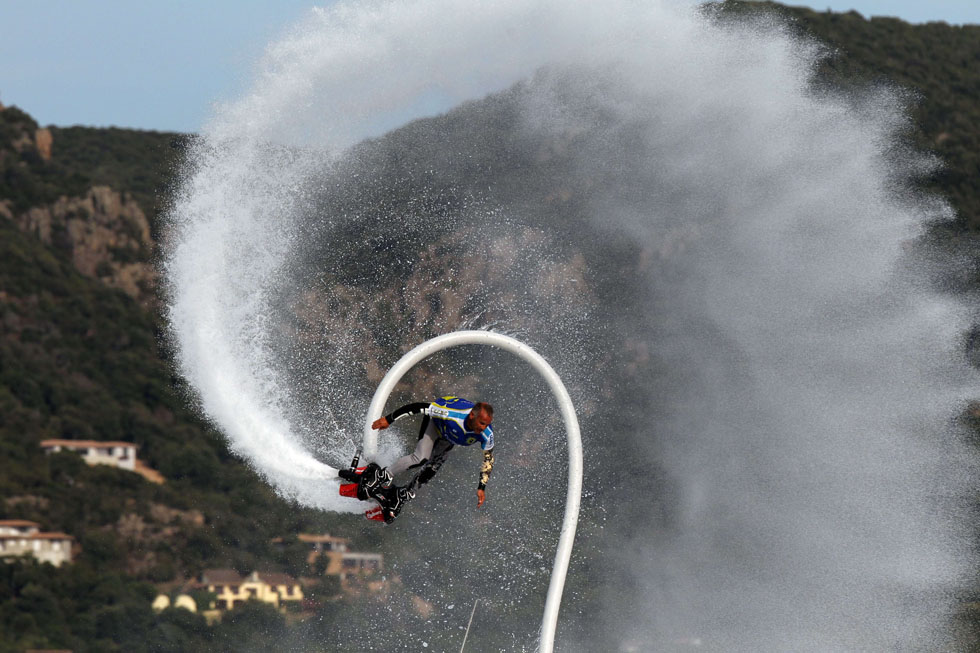 A man performs with a flyboard on at Porto-Vecchio on the French island of Corsica. The 100th edition of the Tour de France bicycle race kicks off on June 29 in Corsica, and runs through July 21. AFP PHOTO/PASCAL POCHARD-CASABIANCA/AFP/Getty Images