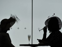 Racing enthusiasts enjoy a cocktail on the fourth day of the horse racing festival at Royal Ascot on June 21, 2013. AFP PHOTO/CARL COURT/AFP/Getty Images