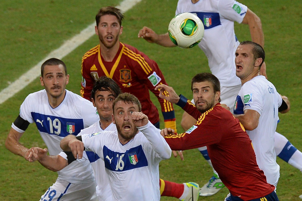 Italian (in white) and Spanish players eye the ball during their FIFA Confederations Cup Brazil 2013 semifinal football match, at the Castelao Stadium in Fortaleza, Brazil, June 27, 2013. AFP PHOTO/YASUYOSHI CHIBA/AFP/Getty Images