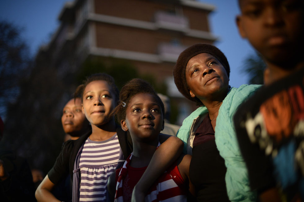 Supporters gather outside the Heart Hospital in Pretoria to pay their respects to ailing former South African President Nelson Mandela, June 27, 2013. REUTERS/Dylan Martinez