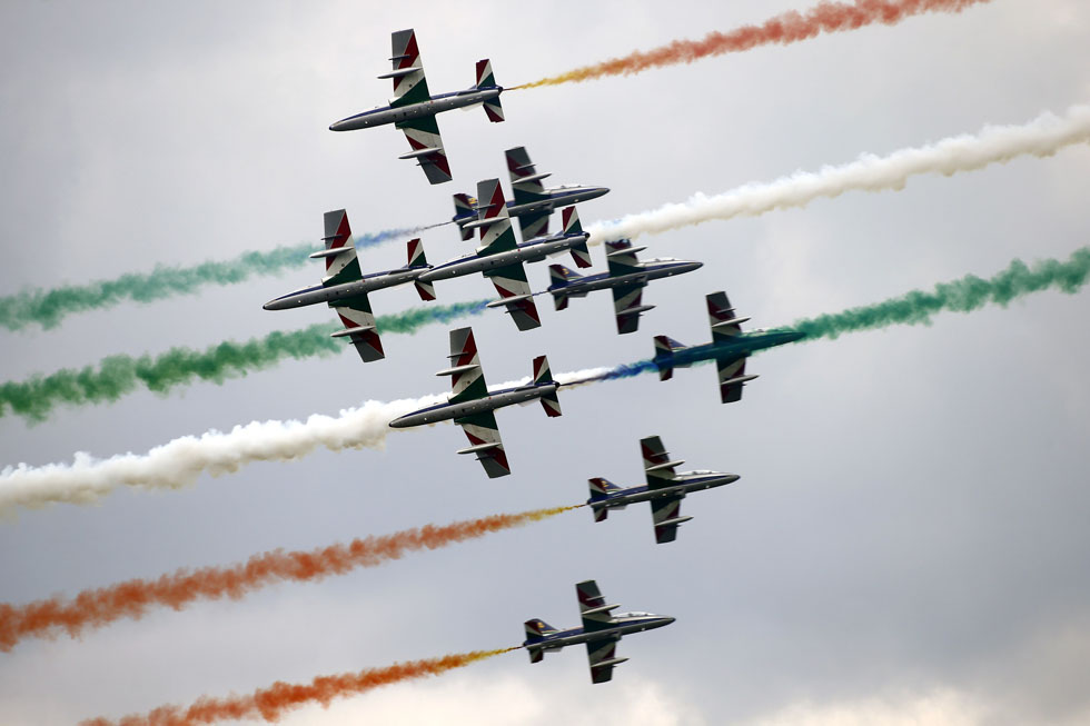 Members of the  Italian aerobatic team, Frecce Tricolori, perform during the AirPower 13 air show at the Hinterstoisser air base in Zeltweg, Austria, June 28, 2013. Over 200,000 spectators are expected to attend the air show which takes place June 28 to 29.  REUTERS/Dominic Ebenbichler