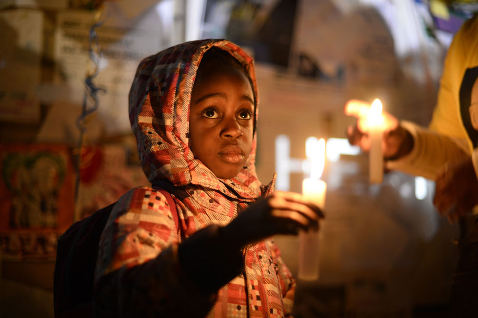 Well-wishers hold candles as they gather in support of ailing former South African President Nelson Mandela. outside the Medi-Clinic Heart Hospital where he is being treated in Pretoria, South Africa, June 27, 2013. REUTERS/Dylan Martinez