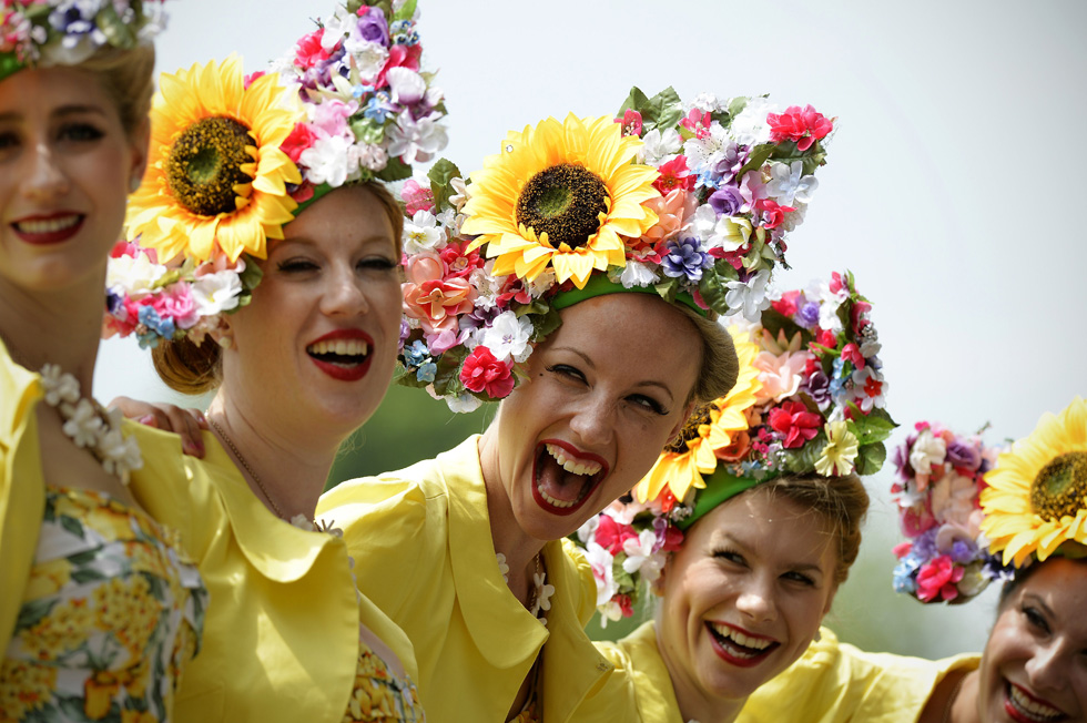 Members of The Tootsie Rolls, a retro girl band, pose for pictures during the second day of Royal Ascot. AFP PHOTO/ADRIAN DENNIS /AFP/Getty Images