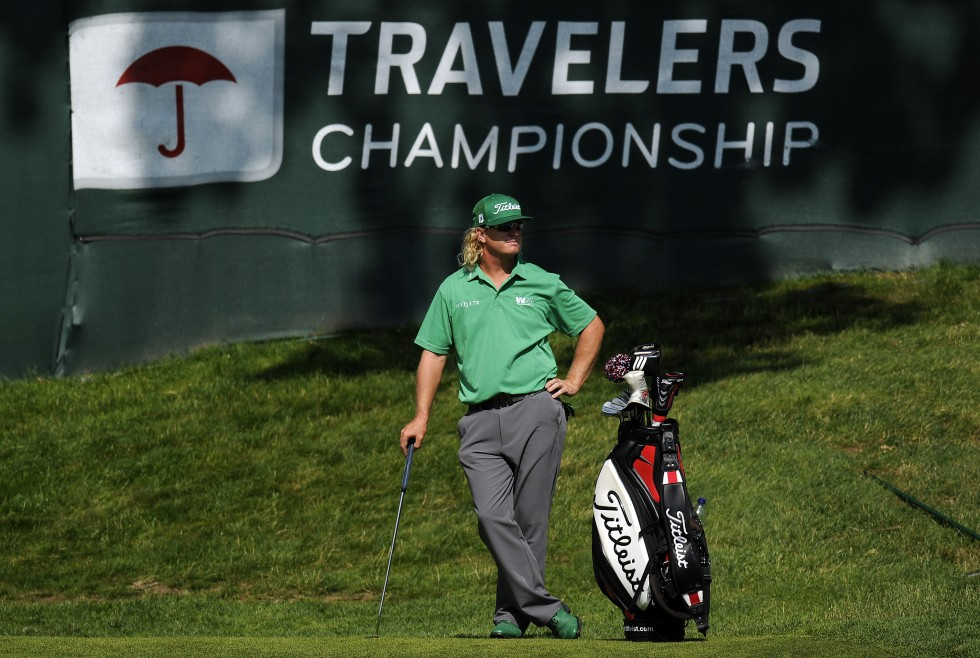 Charlie Hoffman sits atop the Travelers Championship leader board with a 9 under 61 during the opening round of the 2013 Travelers Championship at the TPC River Highlands in Cromwell Thursday. Hoffman looks out over the 17th green waiting for his turn to putt.