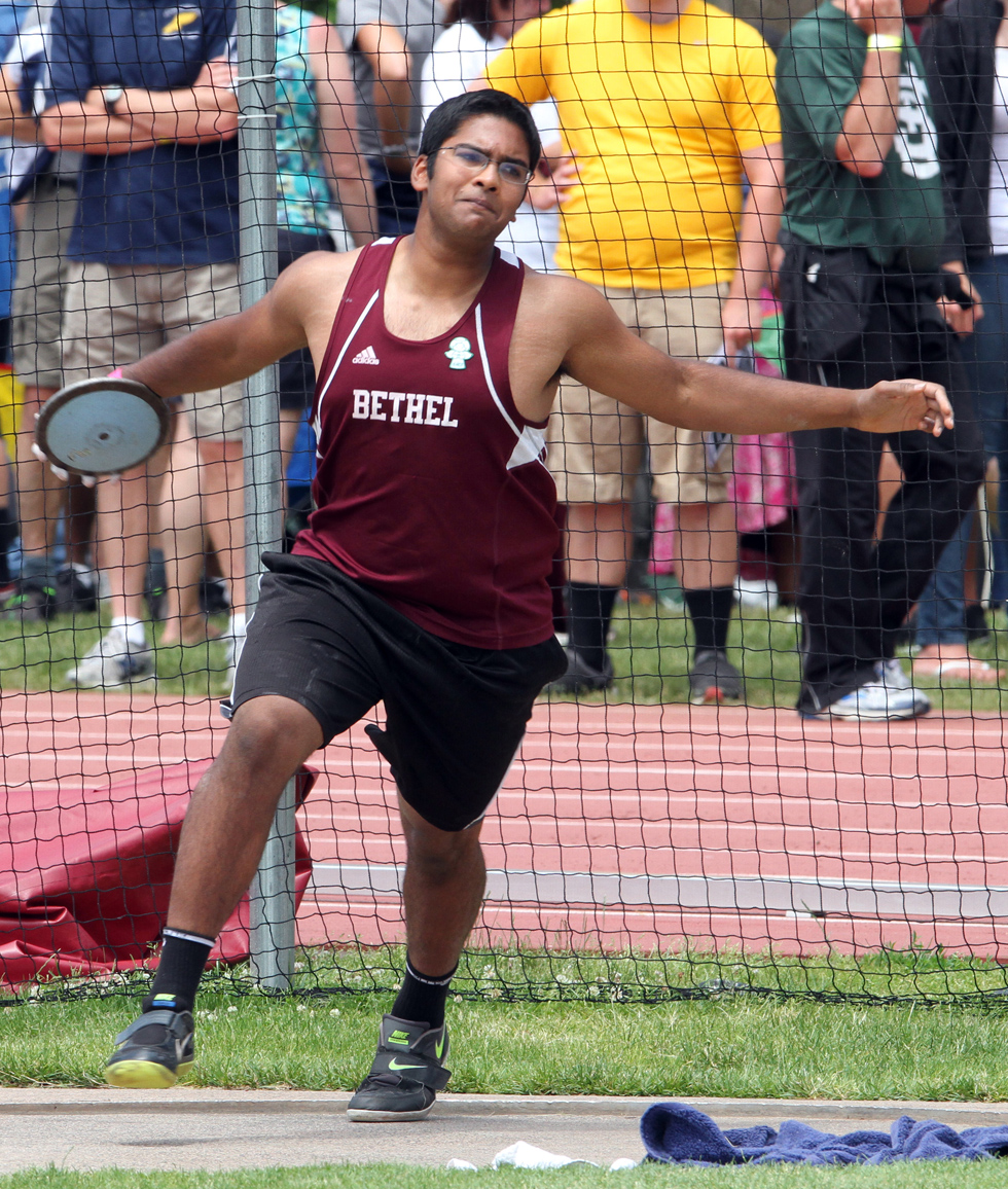 June 8, 2013:  Avhi Shek,  of Bethel High School, throws the discus at the New England Track and Field Championships. Stan Godlewski/Special to the Courant