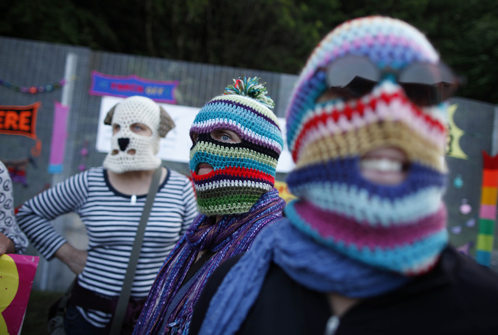 Protesters wearing knitted balaclavas protest near the G8 Summit at Lough Erne Resort in Enniskillenin,Northern Ireland, June 17, 2013. The G8 summit of leading industrial nations kicked off in Northern Ireland with Western leaders, upping pressure on Russia over its support for Syria's regime. AFP PHOTO/PETER MUHLY