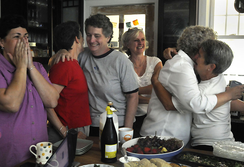 Couples and friends celebrate at the West Hartford, CT, home of Beth Kerrigan and Jody Mock, moments after the U.S. Supreme Court struck down the Defense of Marriage Act. Kerrigan and Moss were the lead plaintiffs in the 2008 court case that led to the legalization of gay marriage in Connecticut. From left are Carol Buckheit, of Avon, Tracy Wilson and her wife State Senator Beth Bye, of West Hartford, Jamey Bell of Bloomfield, Jamie Mills of Middletown, and Beth Kerrigan. MICHAEL McANDREWS|mmcandrews@courant.com
