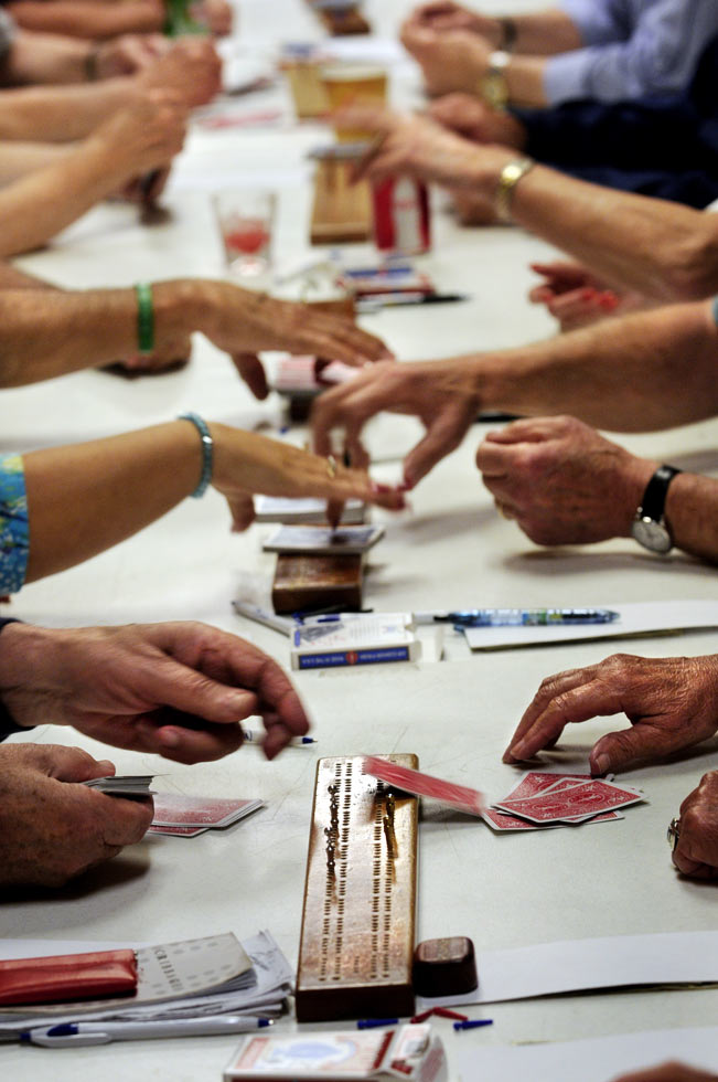 Cards are flying over cribbage boards set up at long tables for the weekly meeting of the Hartford Metro Cribbage Club. More than 30 members meet on Monday nights at the Moose Lodge for some competitive games