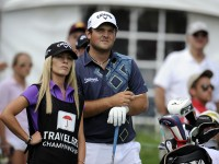 Pro Patrick Reed has his wife Justine on the bag for him during the opening round of the 2013 Travelers Championship. The couple married in December and she has been caddying for him for 145 months. Photo by JOHN WOIKE|woike@courant.com
