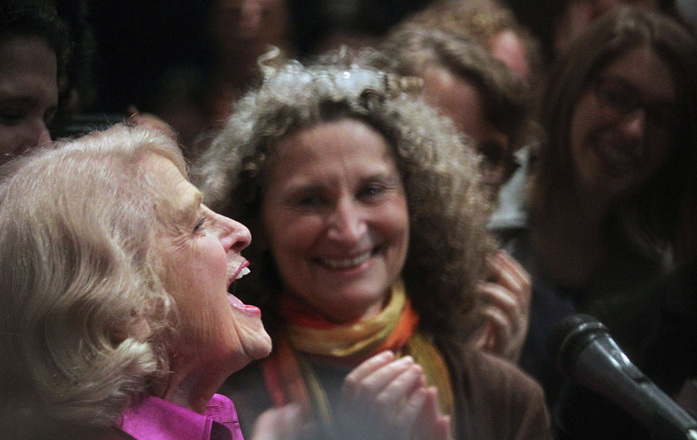 "Defense of Marriage Act plaintiff Edith ""Edie"" Windsor (L) celebrates with supporters in Manhattan following the U.S. Supreme Court ruling that the DOMA is unconstitutional, June 26, 2013, in New York City. It was the death of Windsor's life partner of 42 years, Thea Clara Spyer, which led to the case. The high court ruled that supporters of California's ban on gay marriage, Proposition 8, could not defend it before the Supreme Court.  (Photo by Mario Tama/Getty Images)"
