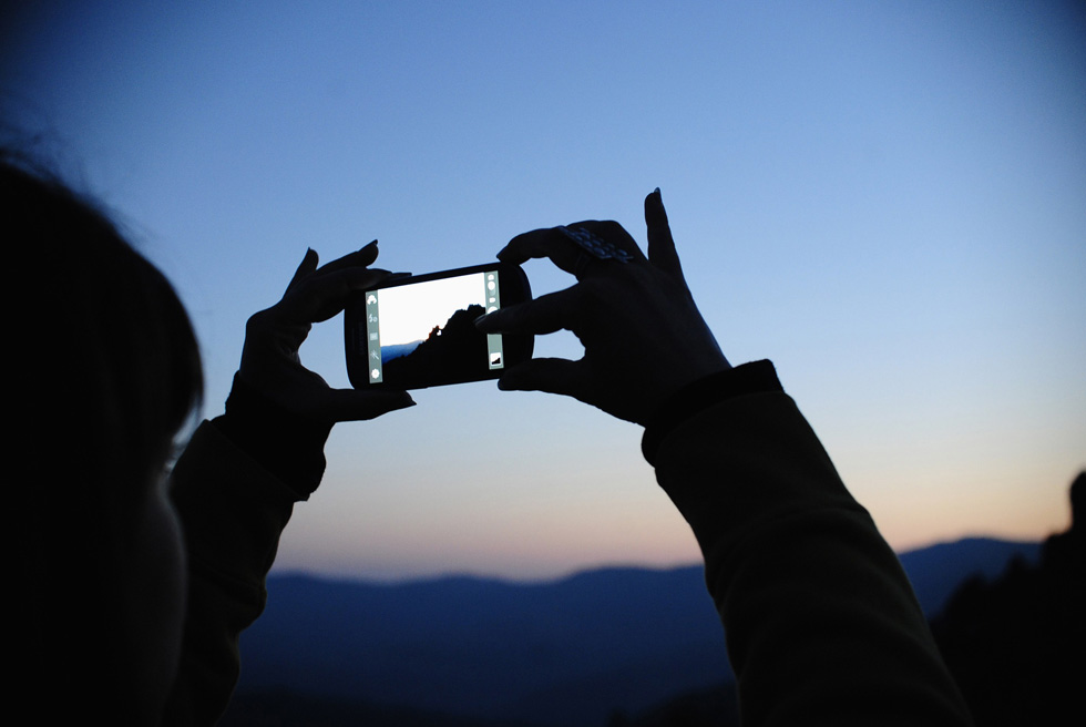 A girl takes photos of the Kokino megalithic observatory during the summer solstice celebration in Kumanovo, Macedonia, on June 21, 2013. The 3,800 year-old observatory was discovered in 2001 and , according to NASA, is ranked as the fourth oldest observatory in the world after Egypt's Abu Simbel, Britain's Stonehenge and Cambodia's Angkor Wat.  REUTERS/Ognen Teofilovski
