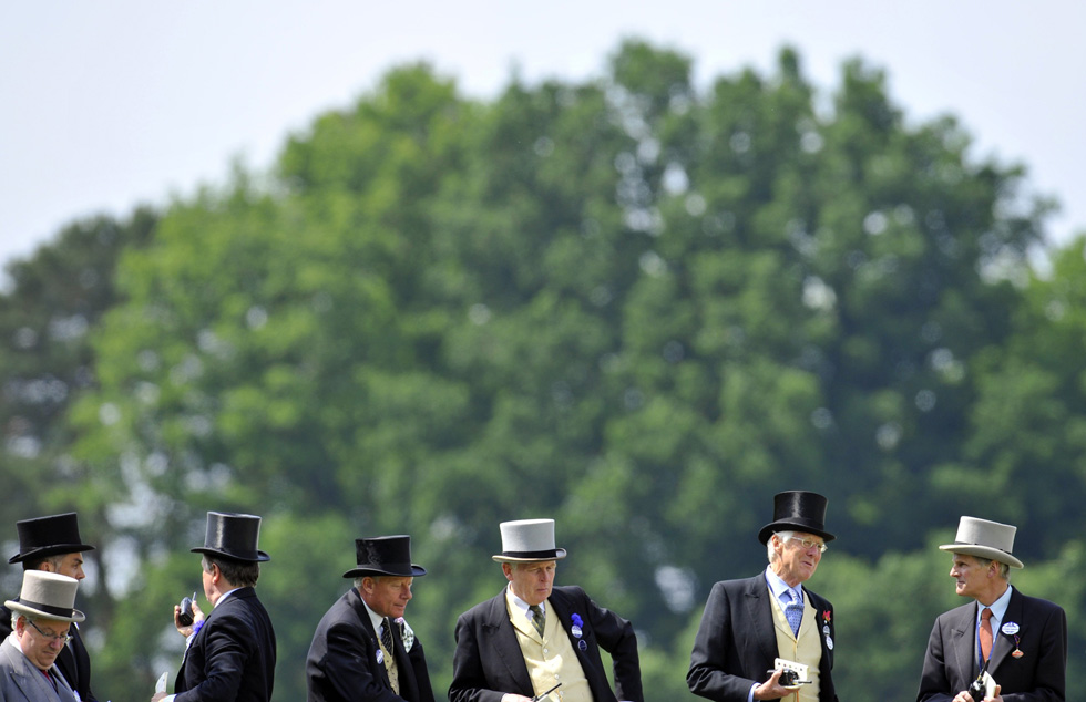 Racegoers watch on the fourth day of the Royal Ascot horse racing festival at Ascot in southern England June 21, 2013. REUTERS/Toby Melville