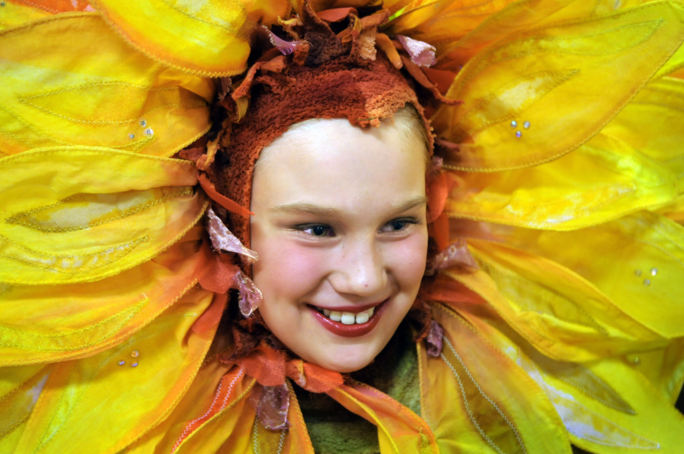 "Delaney Fox, 10, of West Hartford, waits backstage in her sunflower costume before the final dress rehearsal of ""Snow White."" Snow White features 154 dancers ranging in age from 5 to 17 from Hartt School of Music's Pre-Professional, and Children's Ballet programs. STEPHEN DUNN