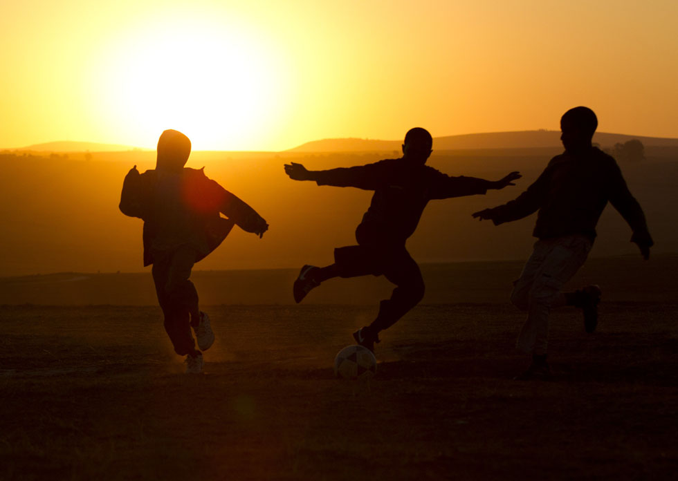 Boys play soccer near the home of former South African President Nelson Mandela in Qunu, South Arica, June 28, 2013. REUTERS/Rogan Ward