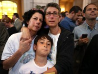 Sue Rochman (L) and Robin Romdalvik (R) stand with their son Maddox Rochman-Romdalvik as they await the U.S. Supreme Court's ruling on gay marriage at City Hall in San Francisco, June 26, 2013. (Photo by Justin Sullivan/Getty Images)