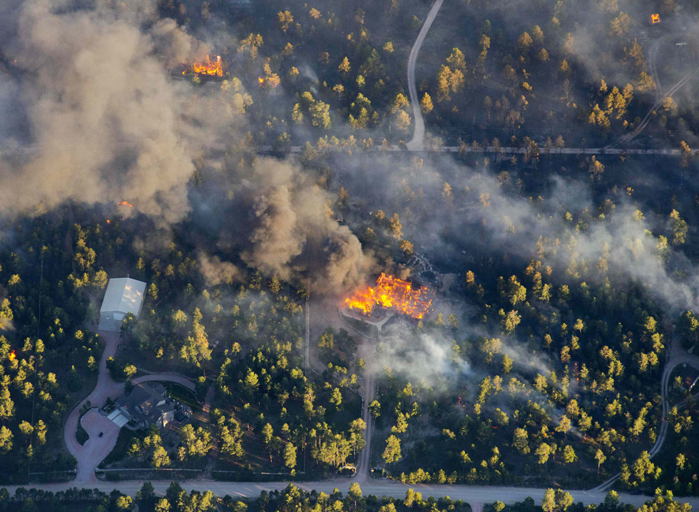 Homes burn near Colorado Springs, Colorado. A fierce, wind-whipped wildfire destroyed more than 90 homes and menaced additional communities in and around Colorado's second-largest city, forcing thousands of residents to flee. REUTERS/John Wark