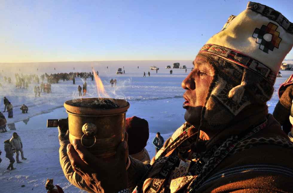 An Aymara priest participates in a ritual at sunrise to celebrate the Aymara New Year on June 21, 2013, at the Uyuni salt flat in Bolivia. Crowds gathered to receive the first rays of Tata Inti during the celebration of the winter solstice that marks the beginning of the 5521st year in the Aymara calendar. AFP/PHOTO/Aizar RALDES /AFP/Getty Images
