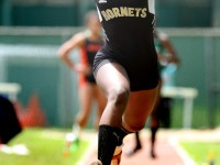 June 8, 2013:  Dana Bramble, of the East Hartford Hornets, does the triple-jump during the New England Track and Field Championships. Stan Godlewski/Special to the Courant
