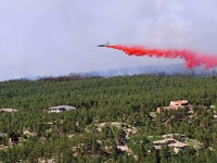 An aircraft releases fire-retardant solution to help stop the spread of fire in Colorado's Black Forest. A fierce, wind-whipped wildfire destroyed more than 90 homes and menaced additional communities in and around Colorado's second-largest city, forcing thousands of residents to flee. REUTERS/US Army/Sgt. Jonathan C. Thibault/Handout via Reuters