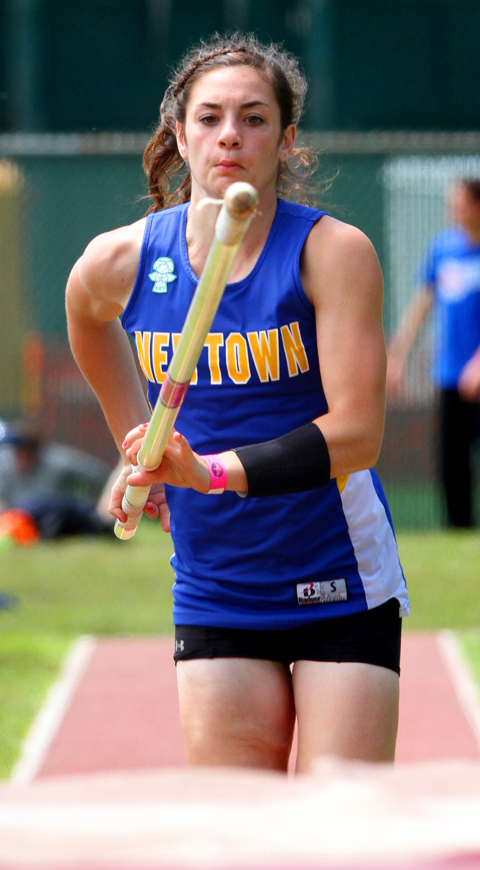 June 8, 2013: Newtown's Jenna Calandro prepares for take-off during the pole vault competition at the New England Track and Field Championships.Stan Godlewski/Special to the Courant