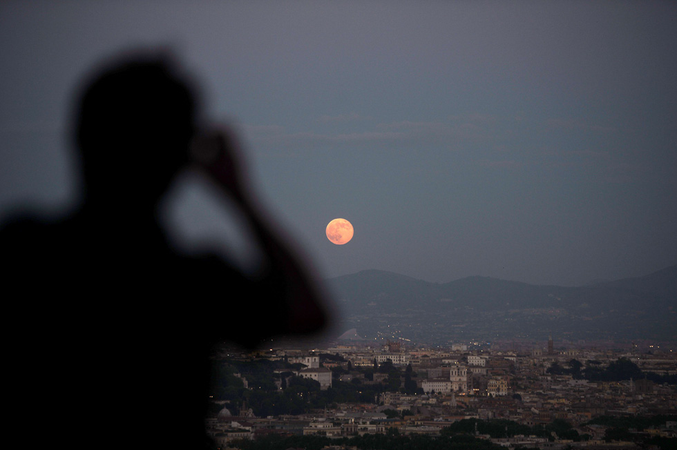 A rising moon is seen over the city of Rome on June 23, 2013. The full moon at perigee is called a Supermoon, and is the largest and closest full moon of the year as it appears 14 percent larger and 30 percent brighter than normal. .AFP PHOTO / Filippo MONTEFORTE/AFP/Getty Images