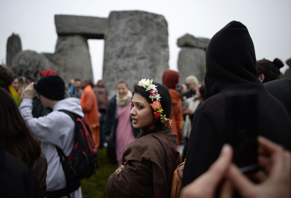 Revellers celebrate the summer solstice at the ancient Stonehenge monument on Salisbury Plain in southern England, June 21, 2013. Stonehenge is a celebrated venue of festivities during the summer solstice - the longest day of the year in the northern hemisphere - and it attracts thousands of revellers, spiritualists and tourists. Druids, a pagan religious order dating back to Celtic Britain, believe Stonehenge was a center of spiritualism more than 2,000 years ago.  REUTERS/Dylan Martinez