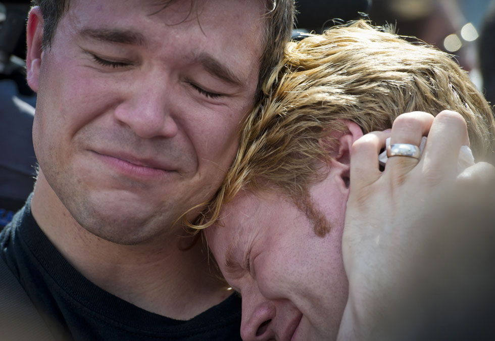 Michael Knaapen (L) and his husband John Becker react moments after hearing the US Supreme Court ruling that the federal Defense of Marriage act was unconstitutional, outside the court in Washington DC. The US Supreme Court on Wednesday struck down a controversial federal law that defines marriage as a union between a man and a woman, in a major victory for supporters of same-sex marriage. DOMA had denied married gay and lesbian couples in the United States the same rights and benefits that straight couples have long taken for granted. AFP PHOTO/ANTONOV MLADEN /AFP/Getty Images