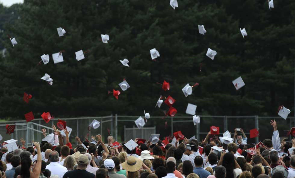 -  6/24/2013  - West Hartford;  A flurry of mortarboards fly through the air as Conard High School graduates celebrate their achievement Monday at the West Hartford schoool.