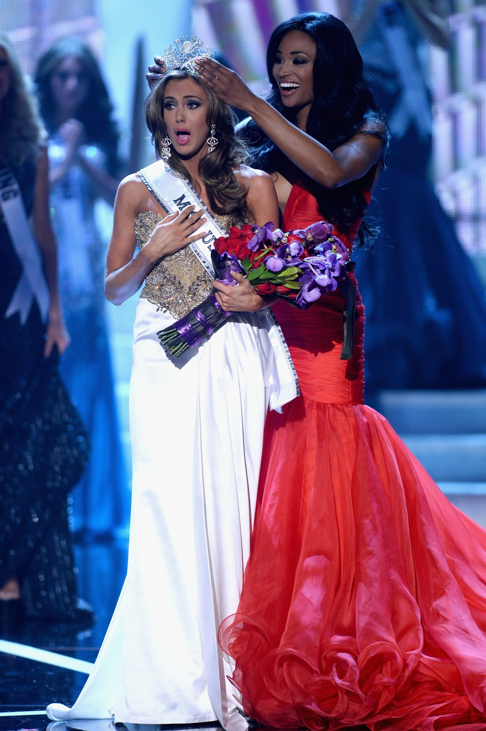 LAS VEGAS, NV - JUNE 16:  Miss USA 2012 Nana Meriwether crowns Miss Connecticut USA Erin Brady the new Miss USA during the 2013 Miss USA pageant at PH Live at Planet Hollywood Resort & Casino on June 16, 2013 in Las Vegas, Nevada.  (