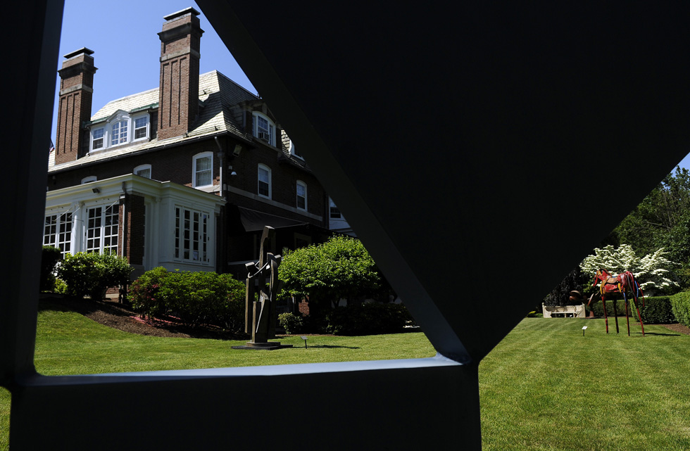 A new sculpture park at the Governor's Mansion, featuring 24 Connecticut artists and 18 works, will open to the public on Monday, June 17. A piece by Arthur Carter called Mathematika frames works by Denis Folz (L) titled Lookout, Big Red (R) by Marcia Spivak and beyond Big Red is Kinetic Milkweed by David Boyajian. JOHN WOIKE | jwoike@courant.com