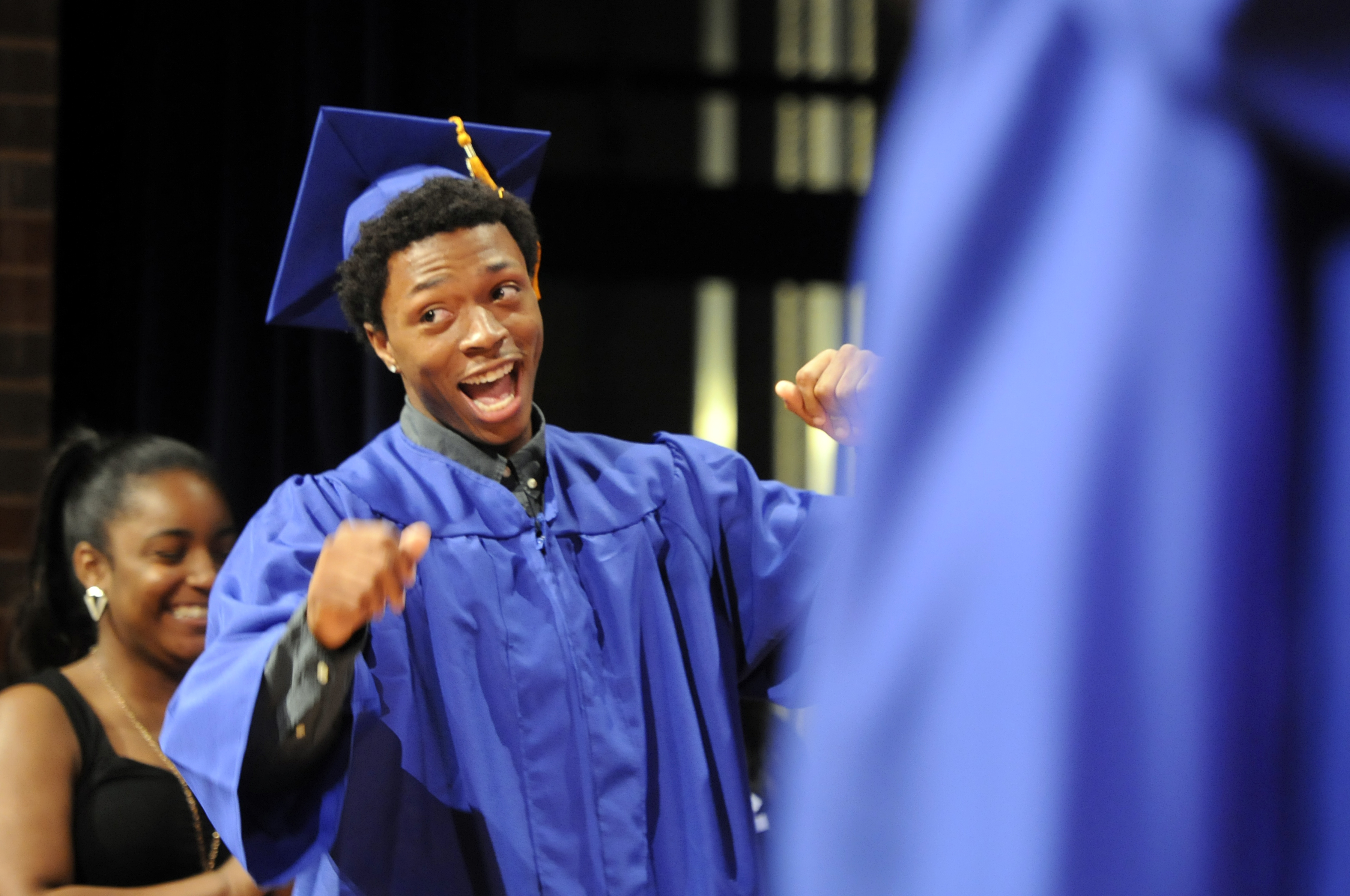Avaughn Brown reacts to his name being called as he walked to receive his degree.